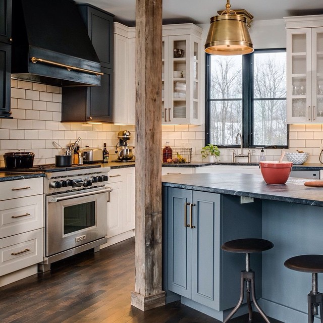 Black & white kitchen cabinet + gold pendant lighting + light blue island + wood beam !