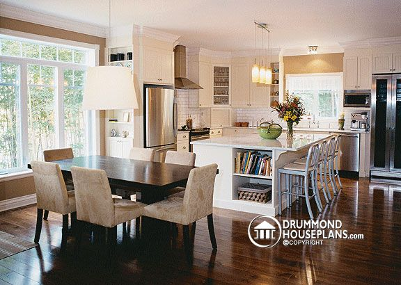 wraparound porch house with large kitchen island